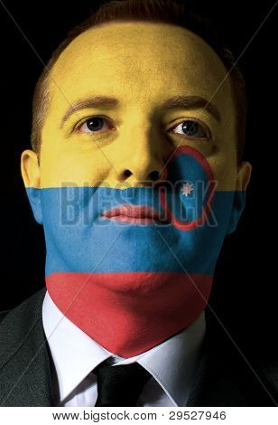 Face Of Serious Businessman Or Politician Painted In Colors Of Colombia Flag