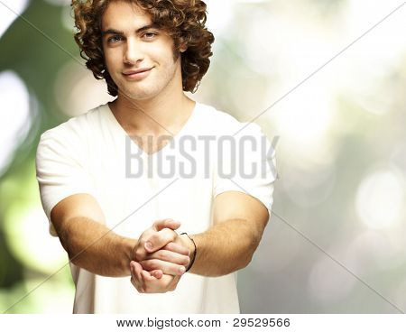 portrait of a young man gesturing contract against an abstract background