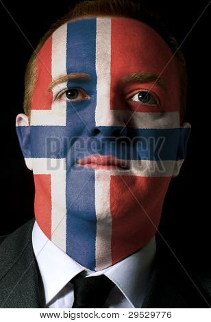 Face Of Serious Businessman Or Politician Painted In Colors Of Norway Flag