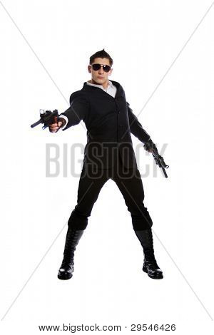 Young man in black suit holding gun isolated on white background