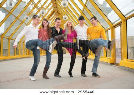 Group Of Young People Dance Cancanon Footbridge