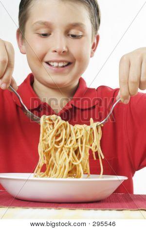 Child Tossing Pasta