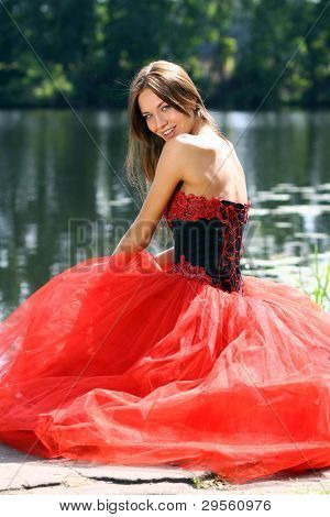 Smiling woman in a red dress