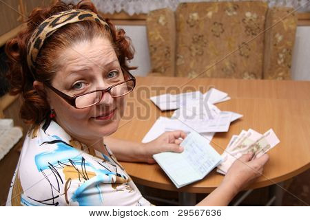 old woman counts money