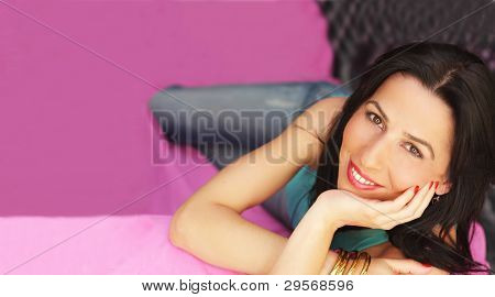 Young Woman Smiling On Couch