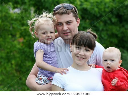 Family of four enjoying outdoors
