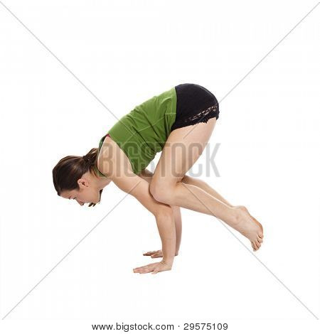young woman doing yoga, in handstand, with clipping path