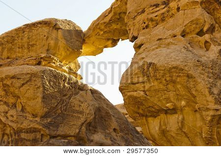 Sandstone Natural Bridge In The Wadi Rum