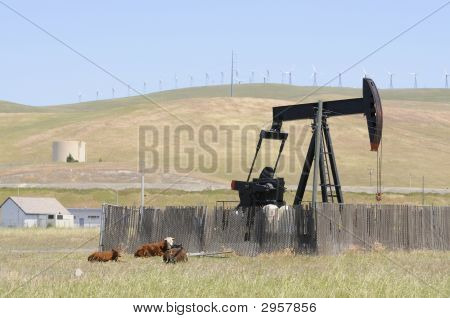 Oil Well Pump With Wind Generators In The Background
