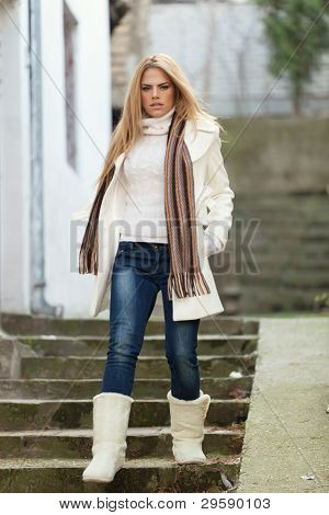 Winter Portrait Of Beautiful Young Woman On Stairs