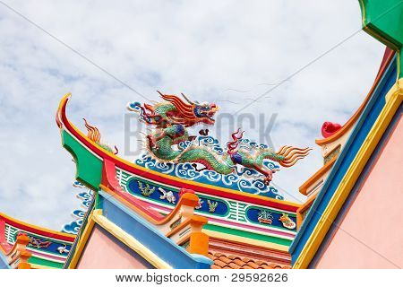 Colorful Chinese Dragon Sculpture On Temple Roof