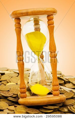 Time is money concept - hourglass and coins