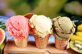 Set Of Ice Cream Scoops Of Different Colors And Flavours With Berries And Fruits poster