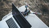 Fpv Drone Lies On The Table Near The Laptop And Control Panel. The Pilot Sets Up His Racing Drone Be poster