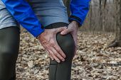 A Man In Training Clothes Got A Knee Injury While Jogging In Outdoor Workout. Concept Of Sports Inju poster