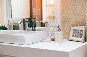 Interior Of Bathroom With Sink Basin Faucet And Mirror. Modern Design Of Bathroom. poster