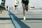 Running On City Road. Marathon Running In The Morning Light . Athlete Runner Feet Running. Young Run poster