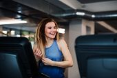 A Portrait Of Young Girl Or Woman Doing Cardio Workout In A Gym. poster