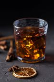 Glass Of Brandy Or Whiskey, Spices And Decorations On Dark Background. Seasonal Holidays Concept. poster