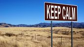 Keep Calm Word On Road Sign And Blue Sky poster