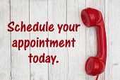 Schedule Your Appointment Today Text With Retro Red Phone Handset On Weathered Whitewash Textured Wo poster