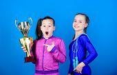 Deserved Award. Girls Athletic Kids Celebrate Victory. Athletic Girls With Golden Goblet. Win Champi poster