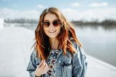 Young Beautiful Happy Woman With Wavy Hair In Sunglasses Walking Around The City Along The River poster