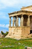 Porch Of The Caryatids Of Erechtheion Ancient Greek Temple In Front Of The Blue Sky And White Clouds poster