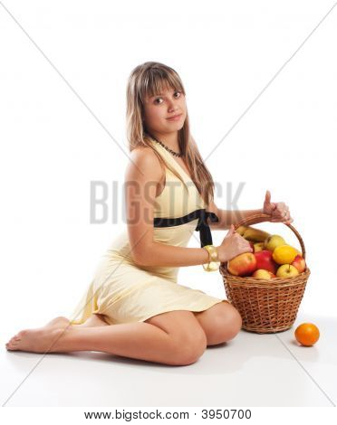 Girl Sitting Near Fruit Basket
