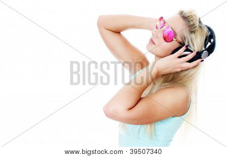 Young Woman Listening Music In Headphones. Isolated On White.
