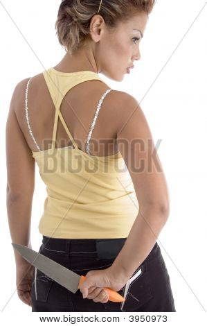 Back Pose Of Woman With Knife