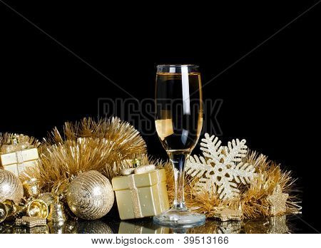 Champagne with Christmas ornaments on black background
