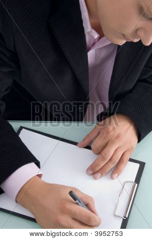 Businessman Writing On Writing Pad