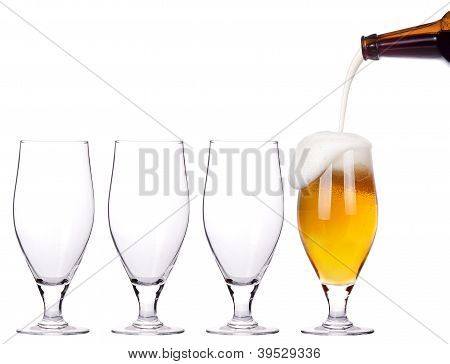 Leader Concept - Empty And One Full Beer Glass