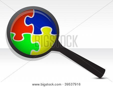 Puzzle Pieces Under Magnifier