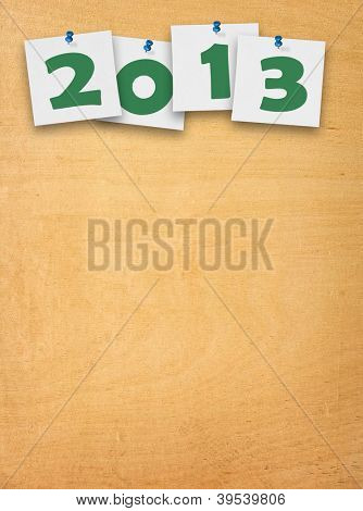 wooden background with 2013 notes