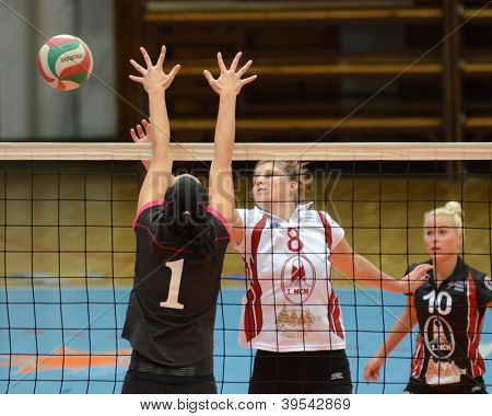 KAPOSVAR, HUNGARY - OCTOBER 14: Timea Kondor (in white) in action at the Hungarian I. League volleyball game Kaposvar (white) vs Nyiregyhaza (black), October 14, 2012 in Kaposvar, Hungary.