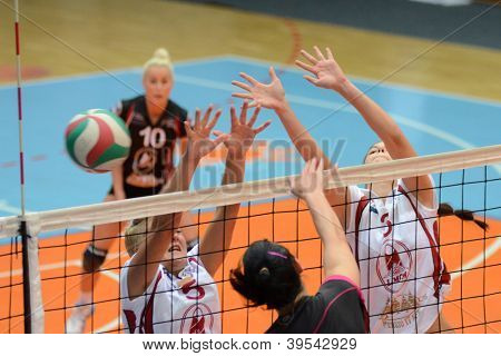 KAPOSVAR, HUNGARY - OCTOBER 14: Unidentified players in action at the Hungarian I. League volleyball game Kaposvar (white) vs Nyiregyhaza (black), October 14, 2012 in Kaposvar, Hungary.