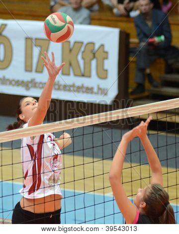 KAPOSVAR, HUNGARY - OCTOBER 14: Zsofia Harmath (L) in action at the Hungarian I. League volleyball game Kaposvar (white) vs Nyiregyhaza (black), October 14, 2012 in Kaposvar, Hungary.