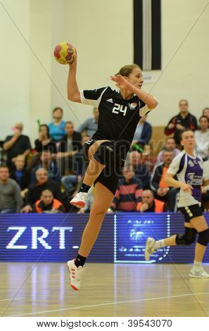 SIOFOK, HUNGARY - NOVEMBER 17: Ildiko Erdosi (in black) in action at EHF Cup handball match Siofok (black) (HUN) vs. Astrakhanochka (purple) (RUS) November 17, 2012 in Siofok, Hungary.