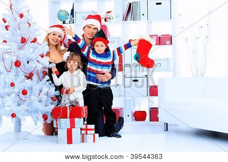 Portrait of a happy family spending Christmas time at home.