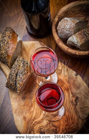 Two glasses of red wine with bread