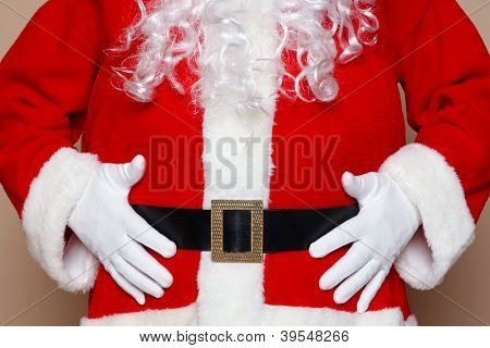Santa Claus holding his belly, two many cookies I think.