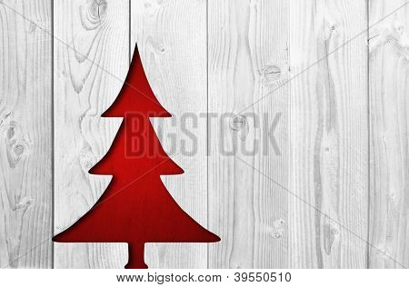 Concept or conceptual vintage old red paper Christmas fir tree over a white wood background as a metaphor to holiday,decoration,celebration,retro,winter,season,greeting,new year,aged,festive or happy