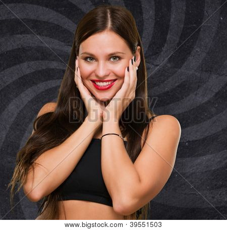 Portrait Of Beautiful Young Woman against a spiral background