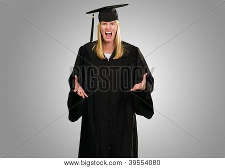 Angry Graduate Woman against a grey background