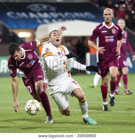 CLUJ-NAPOCA, ROMANIA - NOVEMBER 7: Cadu and Burak Yilmaz in UEFA Champions League match between CFR 1907 Cluj vs Galatasaray, on 7 Nov., 2012 in Cluj-Napoca, Romania