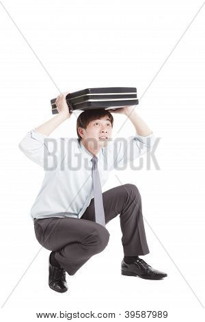 Scared Businessman With Briefcase