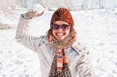 pic of snowball-fight  - Happy young woman playing snowball fight on the snow  day - JPG