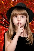 picture of shhh  - Little girl saying be quiet by saying shhh - JPG